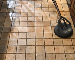 Photo of man cleaning tile floor